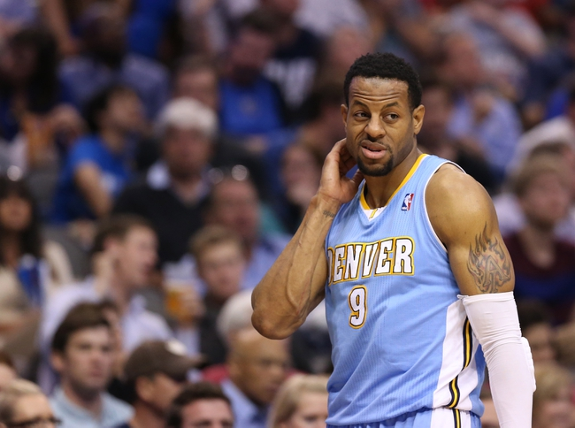 April 12, 2013; Dallas, TX, USA; Denver Nuggets guard Andre Iguodala (9) reacts during the game against the Dallas Mavericks at the American Airlines Center. Mandatory Credit: Matthew Emmons-USA TODAY Sports