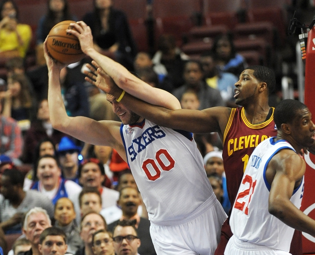 Apr 14, 2013; Philadelphia, PA, USA; Philadelphia 76ers center Spencer Hawes (00) grabs rebound from Cleveland Cavaliers power forward Tristan Thompson (13) during the first quarter at the Wells Fargo Center. Mandatory Credit: Eric Hartline-USA TODAY Sports
