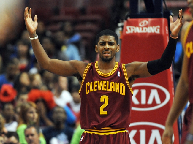 Apr 14, 2013; Philadelphia, PA, USA; Cleveland Cavaliers point guard Kyrie Irving (2) reacts against the Philadelphia 76ers during the first quarter at the Wells Fargo Center. Mandatory Credit: Eric Hartline-USA TODAY Sports