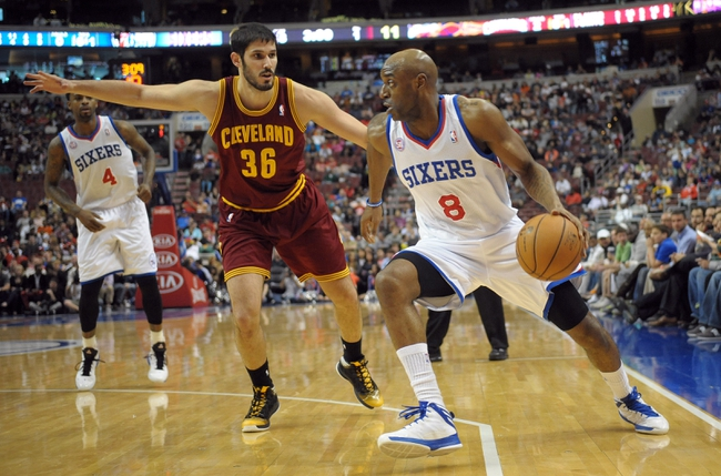 Apr 14, 2013; Philadelphia, PA, USA; Philadelphia 76ers shooting guard Damien Wilkins (8) drives against Cleveland Cavaliers small forward Omri Casspi (36) during the first quarter at the Wells Fargo Center. Mandatory Credit: Eric Hartline-USA TODAY Sports