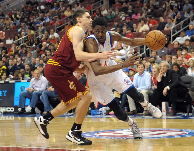 Apr 14, 2013; Philadelphia, PA, USA; Philadelphia 76ers shooting guard Justin Holiday (14) drives against Cleveland Cavaliers point guard Chris Quinn (20) during the fourth quarter at the Wells Fargo Center. The 76ers defeated the Cavaliers, 91-77. Mandatory Credit: Eric Hartline-USA TODAY Sports