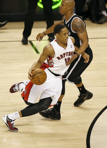 Apr 14, 2013; Toronto, ON, Canada; Toronto Raptors forward DeMar DeRozan (10) drives to the basket against the Brooklyn Nets at the Air Canada Centre. The Raptors beat the Nets 93-87. Mandatory Credit: Tom Szczerbowski-USA TODAY Sports