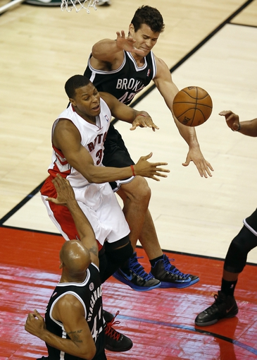 Apr 14, 2013; Toronto, ON, Canada; Brooklyn Nets forward Kris Humphries (43) battles for the ball against Toronto Raptors point guard Kyle Lowry (3) at the Air Canada Centre. The Raptors beat the Nets 93-87. Mandatory Credit: Tom Szczerbowski-USA TODAY Sports