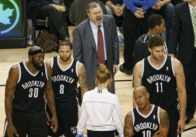 Apr 14, 2013; Toronto, ON, Canada; Brooklyn Nets head coach P.J. Carlesimo yells at his players forward Reggie Evans (30) and point guard Deron Williams (8) and center Brook Lopez (11) and forward Keith Bogans (10) against the Toronto Raptors at the Air Canada Centre. The Raptors beat the Nets 93-87. Mandatory Credit: Tom Szczerbowski-USA TODAY Sports