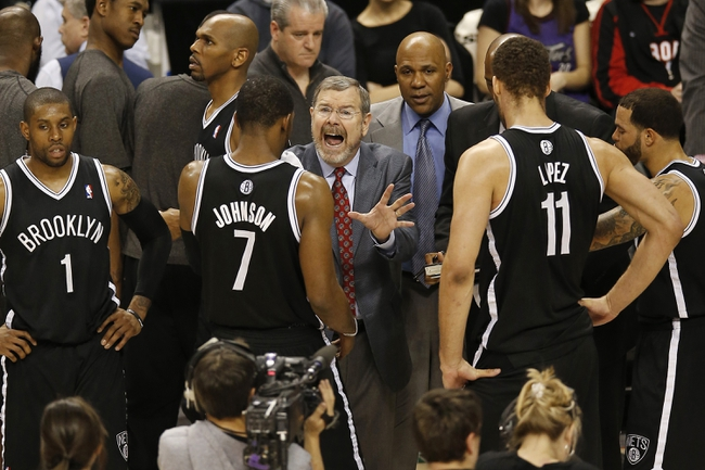 Apr 14, 2013; Toronto, ON, Canada; Brooklyn Nets head coach P.J. Carlesimo talks to his players during a timeout against the Toronto Raptors at the Air Canada Centre. The Raptors beat the Nets 93-87. Mandatory Credit: Tom Szczerbowski-USA TODAY Sports