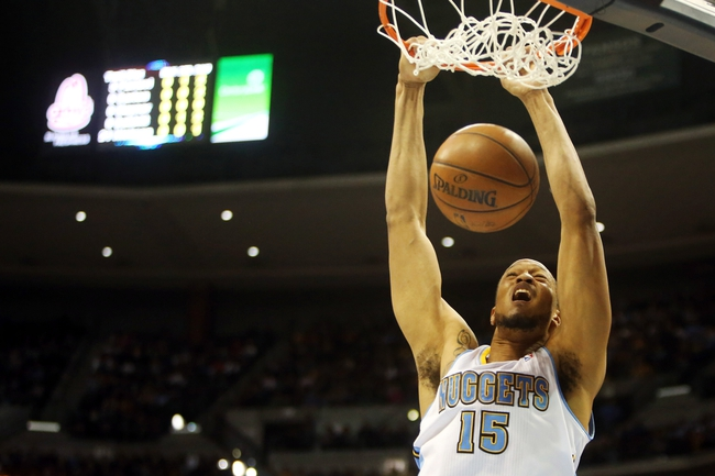 Apr 14, 2013; Denver, CO, USA; Denver Nuggets forward Anthony Randolph (15) dunks the ball during the second half against the Portland Trailblazers at the Pepsi Center. The Nuggets won 118-109.  Mandatory Credit: Chris Humphreys-USA TODAY Sports