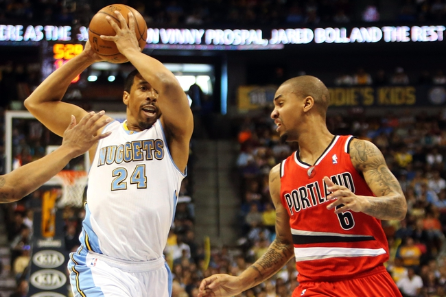 Apr 14, 2013; Denver, CO, USA; Denver Nuggets guard Andre Miller (24) drives to the basket during the second half against the Portland Trailblazers at the Pepsi Center. The Nuggets won 118-109.  Mandatory Credit: Chris Humphreys-USA TODAY Sports