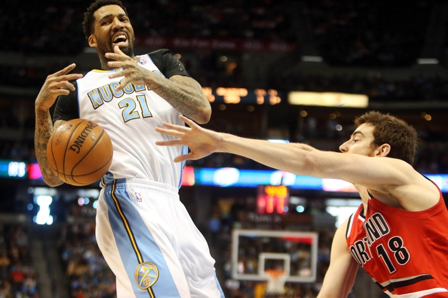 Apr 14, 2013; Denver, CO, USA; Denver Nuggets forward Wilson Chandler (21) is fouled during the second half against the Portland Trailblazers at the Pepsi Center. The Nuggets won 118-109.  Mandatory Credit: Chris Humphreys-USA TODAY Sports