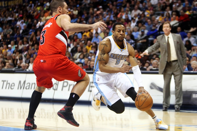 Apr 14, 2013; Denver, CO, USA; Denver Nuggets guard Andre Iguodala (9) drives to the basket during the second half against the Portland Trailblazers at the Pepsi Center. The Nuggets won 118-109.  Mandatory Credit: Chris Humphreys-USA TODAY Sports