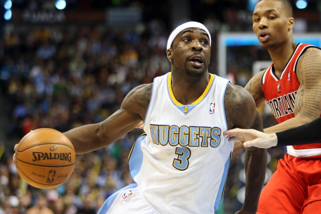 Apr 14, 2013; Denver, CO, USA; Denver Nuggets guard Ty Lawson (3) drives to the basket during the second half against the Portland Trailblazers at the Pepsi Center. The Nuggets won 118-109.  Mandatory Credit: Chris Humphreys-USA TODAY Sports