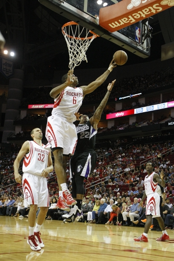 April 14, 2013; Houston, TX, USA; Houston Rockets power forward Terrence Jones (6) blocks the shot of Sacramento Kings point guard Isaiah Thomas (22) in the fourth quarter at the Toyota Center. The Rockets defeated the Kings 121-100. Mandatory Credit: Brett Davis-USA TODAY Sports