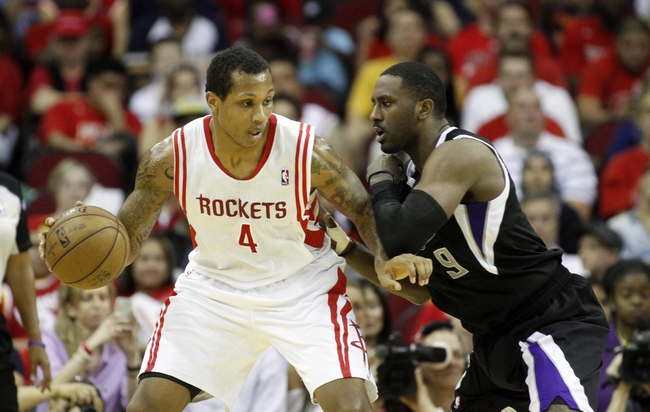 April 14, 2013; Houston, TX, USA; Houston Rockets power forward Greg Smith (4) is defended by Sacramento Kings power forward Patrick Patterson (9) in the third quarter at the Toyota Center. The Rockets defeated the Kings 121-100. Mandatory Credit: Brett Davis-USA TODAY Sports