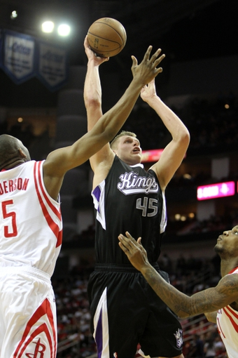 April 14, 2013; Houston, TX, USA; Sacramento Kings center Cole Aldrich (45) takes a shot against the Houston Rockets in the fourth quarter at the Toyota Center. The Rockets defeated the Kings 121-100. Mandatory Credit: Brett Davis-USA TODAY Sports