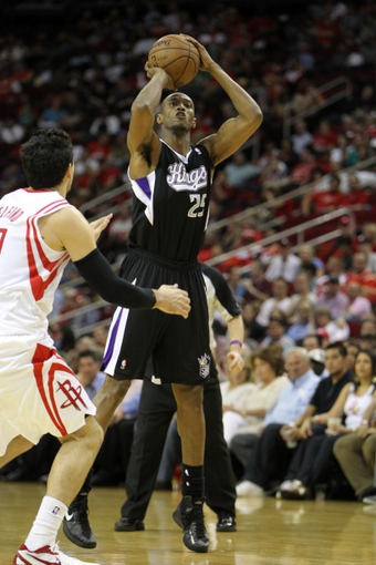 April 14, 2013; Houston, TX, USA; Sacramento Kings small forward Travis Outlaw (25) takes a shot against the Houston Rockets in the third quarter at the Toyota Center. The Rockets defeated the Kings 121-100. Mandatory Credit: Brett Davis-USA TODAY Sports