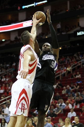 April 14, 2013; Houston, TX, USA; Sacramento Kings power forward Patrick Patterson (9) takes a shot against the Houston Rockets in the fourth quarter at the Toyota Center. The Rockets defeated the Kings 121-100. Mandatory Credit: Brett Davis-USA TODAY Sports