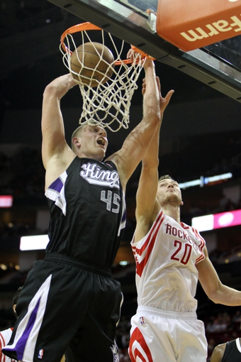 April 14, 2013; Houston, TX, USA; Sacramento Kings center Cole Aldrich (45) dunks the ball against the Houston Rockets in the fourth quarter at the Toyota Center. The Rockets defeated the Kings 121-100. Mandatory Credit: Brett Davis-USA TODAY Sports