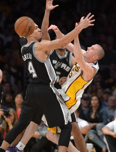 Apr 14, 2013; Los Angeles, CA, USA; Los Angeles Lakers guard Steve Blake (5) is defended by San Antonio Spurs guard Cory Joseph (5) and guard Danny Green (4) at the Staples Center. The Lakers defeated the Spurs 91-88. Mandatory Credit: Kirby Lee-USA TODAY Sports