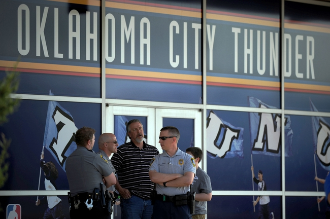 Apr 15, 2013; Oklahoma City, OK, USA; Oklahoma City Police officers are numerous before the Sacramento Kings compete against the Oklahoma City Thunder at Chesapeake Energy Arena on the day of the bombings at the Boston Marathon. Mandatory Credit: Mark D. Smith-USA TODAY Sports