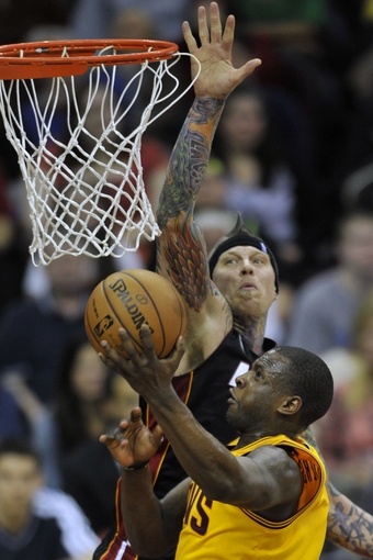 Apr 15, 2013; Cleveland, OH, USA; Miami Heat power forward Chris Andersen (11) defends a shot attempt by Cleveland Cavaliers shooting guard Dion Waiters (3) in the second quarter at Quicken Loans Arena. Mandatory Credit: David Richard-USA TODAY Sports