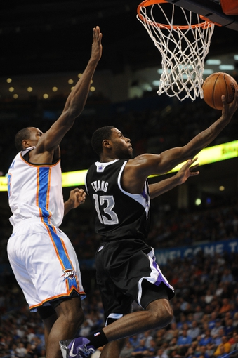 Apr 15, 2013; Oklahoma City, OK, USA; Sacramento Kings guard Tyreke Evans (13) attempts a shot against Oklahoma City Thunder forward Serge Ibaka (9) during the first half at Chesapeake Energy Arena. Mandatory Credit: Mark D. Smith-USA TODAY Sports