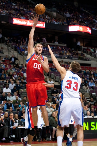 April 15, 2013; Auburn Hills, MI, USA; Philadelphia 76ers center Spencer Hawes (00) shoots over Detroit Pistons power forward Jonas Jerebko (33) during the first quarter at The Palace. Mandatory Credit: Tim Fuller-USA TODAY Sports
