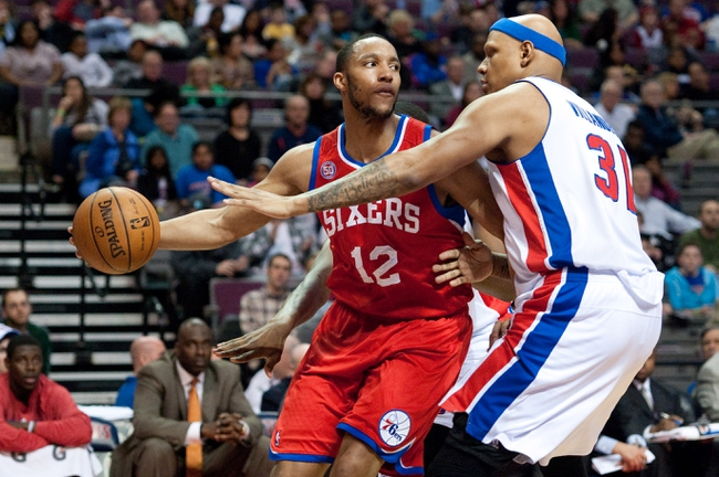 April 15, 2013; Auburn Hills, MI, USA; Detroit Pistons power forward Charlie Villanueva (31) guards Philadelphia 76ers small forward Evan Turner (12) during the second quarter at The Palace. Mandatory Credit: Tim Fuller-USA TODAY Sports
