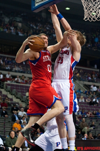 April 15, 2013; Auburn Hills, MI, USA; Philadelphia 76ers center Spencer Hawes (00) goes to the basket against Detroit Pistons shooting guard Kyle Singler (25) during the first quarter at The Palace. Mandatory Credit: Tim Fuller-USA TODAY Sports