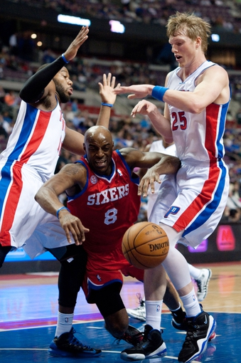 April 15, 2013; Auburn Hills, MI, USA; Philadelphia 76ers shooting guard Damien Wilkins (8) collides with Detroit Pistons center Greg Monroe (left) and shooting guard Kyle Singler (25) during the first quarter at The Palace. Mandatory Credit: Tim Fuller-USA TODAY Sports