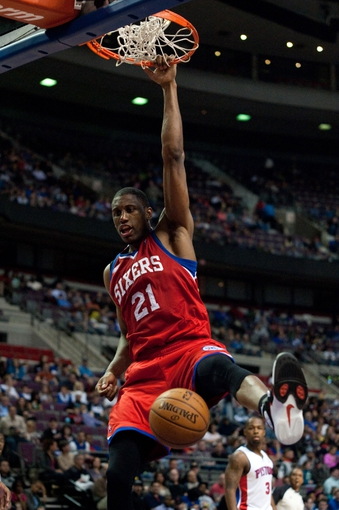 April 15, 2013; Auburn Hills, MI, USA; Philadelphia 76ers small forward Thaddeus Young (21) dunks during the second quarter against the Detroit Pistons at The Palace. Mandatory Credit: Tim Fuller-USA TODAY Sports