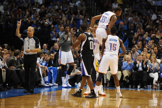 Apr 15, 2013; Oklahoma City, OK, USA; Sacramento Kings guard Toney Douglas (0) argues a call with an NBA official as Oklahoma City Thunder forward Kevin Durant (35) hops off the floor after getting fouled on a 3 point shot during the first half at Chesapeake Energy Arena. Mandatory Credit: Mark D. Smith-USA TODAY Sports