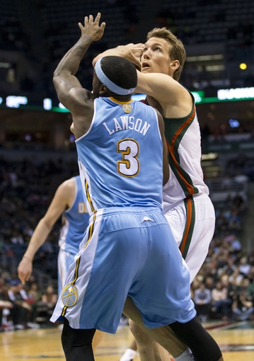Apr 15, 2013; Milwaukee, WI, USA;  Milwaukee Bucks forward Mike Dunleavy (17) looks to shoot against Denver Nuggets guard Ty Lawson (3) during the third quarter at the BMO Harris Bradley Center.  Mandatory Credit: Jeff Hanisch-USA TODAY Sports