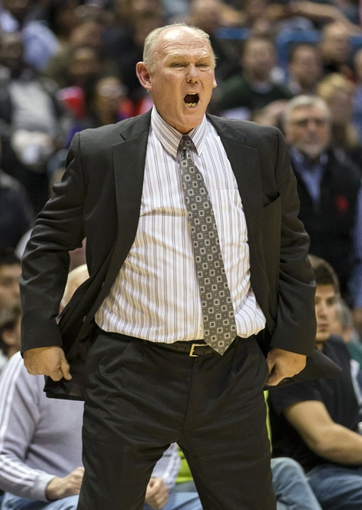 Apr 15, 2013; Milwaukee, WI, USA;  Denver Nuggets head coach George Karl reacts to a call during the third quarter against the Milwaukee Bucks at the BMO Harris Bradley Center.  Mandatory Credit: Jeff Hanisch-USA TODAY Sports