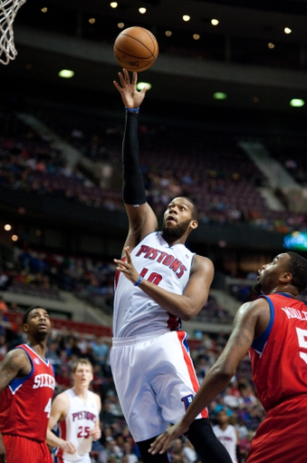 April 15, 2013; Auburn Hills, MI, USA; Detroit Pistons center Greg Monroe (10) shoots during the fourth quarter against the Philadelphia 76ers at The Palace. Detroit won 109-101. Mandatory Credit: Tim Fuller-USA TODAY Sports