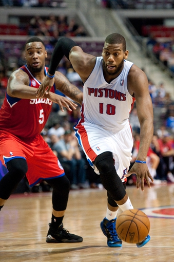 April 15, 2013; Auburn Hills, MI, USA; Detroit Pistons center Greg Monroe (10) drives to the basket against Philadelphia 76ers power forward Arnett Moultrie (5) during the fourth quarter at The Palace. Detroit won 109-101. Mandatory Credit: Tim Fuller-USA TODAY Sports