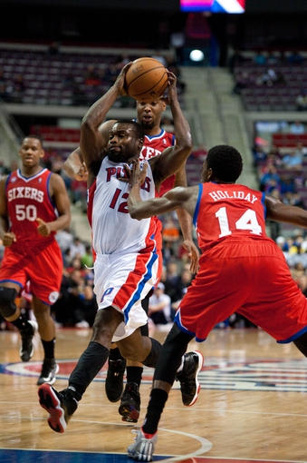 April 15, 2013; Auburn Hills, MI, USA; Detroit Pistons point guard Will Bynum (12) drives to the basket against Philadelphia 76ers shooting guard Justin Holiday (14) during the fourth quarter at The Palace. Detroit won 109-101. Mandatory Credit: Tim Fuller-USA TODAY Sports