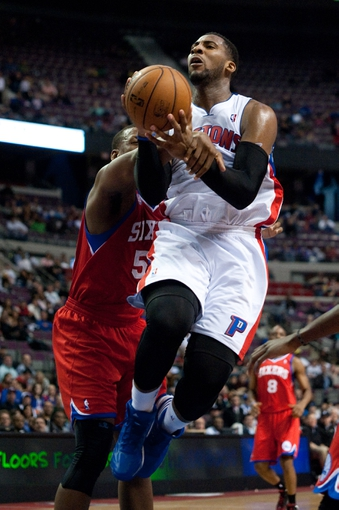 April 15, 2013; Auburn Hills, MI, USA; Philadelphia 76ers power forward Arnett Moultrie (5) fouls Detroit Pistons center Andre Drummond (1) during the fourth quarter at The Palace. Detroit won 109-101. Mandatory Credit: Tim Fuller-USA TODAY Sports