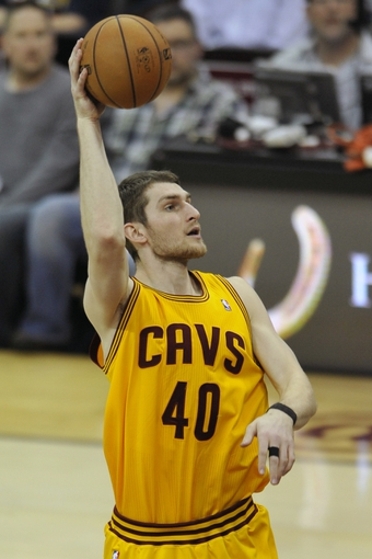 Apr 15, 2013; Cleveland, OH, USA; Cleveland Cavaliers center Tyler Zeller (40) shoots against the Miami Heat in the fourth quarter at Quicken Loans Arena. Mandatory Credit: David Richard-USA TODAY Sports