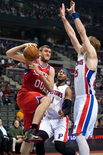 April 15, 2013; Auburn Hills, MI, USA; Philadelphia 76ers center Spencer Hawes (00) goes to the basket against Detroit Pistons center Andre Drummond (1) and shooting guard Kyle Singler (25) during the first quarter at The Palace. Mandatory Credit: Tim Fuller-USA TODAY Sports