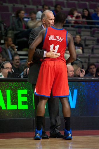 April 15, 2013; Auburn Hills, MI, USA; Philadelphia 76ers head coach Doug Collins talks with point guard Jrue Holiday (11) during the first quarter against the Detroit Pistons at The Palace. Mandatory Credit: Tim Fuller-USA TODAY Sports