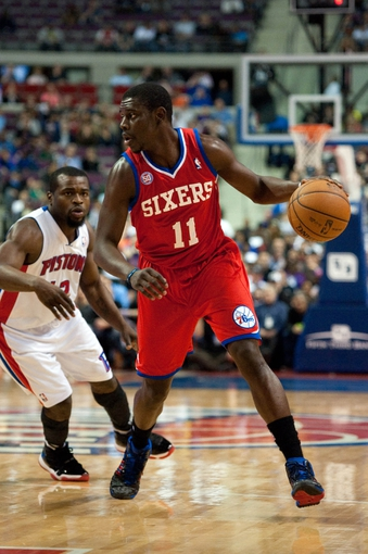 April 15, 2013; Auburn Hills, MI, USA; Philadelphia 76ers point guard Jrue Holiday (11) drives past Detroit Pistons point guard Will Bynum (12) during the first quarter at The Palace. Mandatory Credit: Tim Fuller-USA TODAY Sports