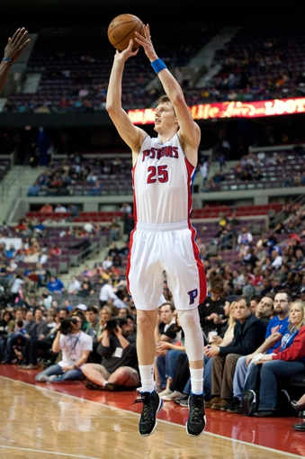 April 15, 2013; Auburn Hills, MI, USA; Detroit Pistons shooting guard Kyle Singler (25) shoots during the third quarter against the Philadelphia 76ers at The Palace. Detroit won 109-101. Mandatory Credit: Tim Fuller-USA TODAY Sports