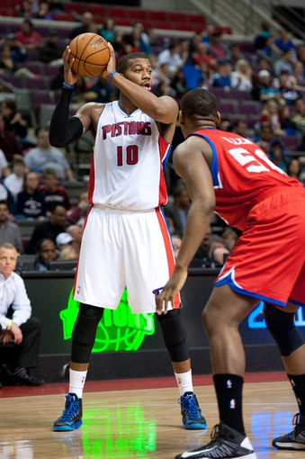 April 15, 2013; Auburn Hills, MI, USA; Philadelphia 76ers center Lavoy Allen (50) guards Detroit Pistons center Greg Monroe (10) during the third quarter at The Palace. Detroit won 109-101. Mandatory Credit: Tim Fuller-USA TODAY Sports