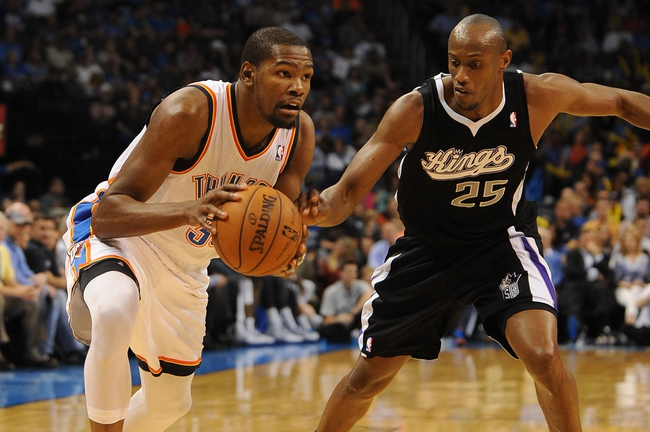Apr 15, 2013; Oklahoma City, OK, USA; Oklahoma City Thunder forward Kevin Durant (35) handles the ball against Sacramento Kings forward Travis Outlaw (25) during the first half at Chesapeake Energy Arena. Mandatory Credit: Mark D. Smith-USA TODAY Sports
