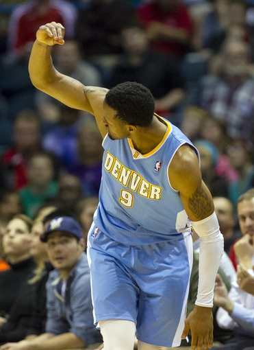 Apr 15, 2013; Milwaukee, WI, USA;  Denver Nuggets guard Andre Iguodala (9) reacts after scoring during the fourth quarter against the Milwaukee Bucks at the BMO Harris Bradley Center.  Denver won 112-111.  Mandatory Credit: Jeff Hanisch-USA TODAY Sports