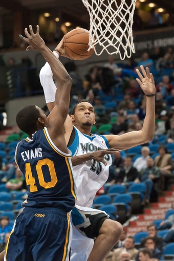Apr 15, 2013; Minneapolis, MN, USA; Minnesota Timberwolves power forward Chris Johnson (20) drives to the basket and Utah Jazz small forward Jeremy Evans (40) defends in the fourth quarter at Target Center. The Jazz won 96-80. Mandatory Credit:  Greg Smith-USA TODAY Sports