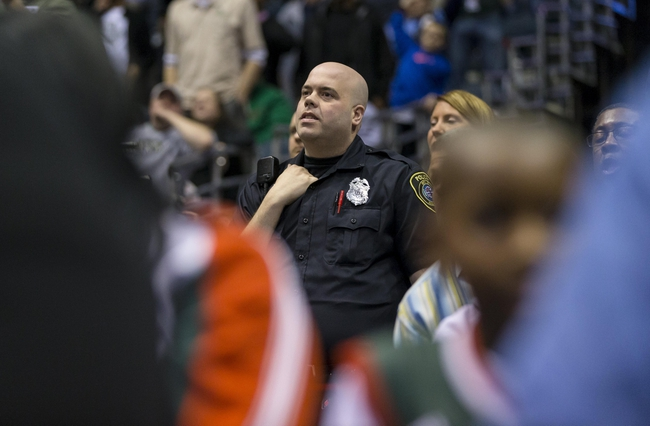Apr 15, 2013; Milwaukee, WI, USA;  A Milwaukee police department officer looks on during the fourth quarter of the game between the Denver Nuggets and Milwaukee Bucks at the BMO Harris Bradley Center.  Denver won 112-111.  Mandatory Credit: Jeff Hanisch-USA TODAY Sports