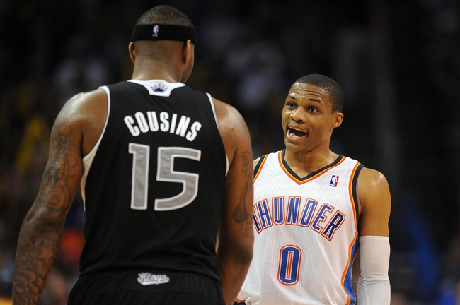 Apr 15, 2013; Oklahoma City, OK, USA; Oklahoma City Thunder guard Russell Westbrook (0) talks to Sacramento Kings center DeMarcus Cousins (15) during the second half at Chesapeake Energy Arena. Mandatory Credit: Mark D. Smith-USA TODAY Sports
