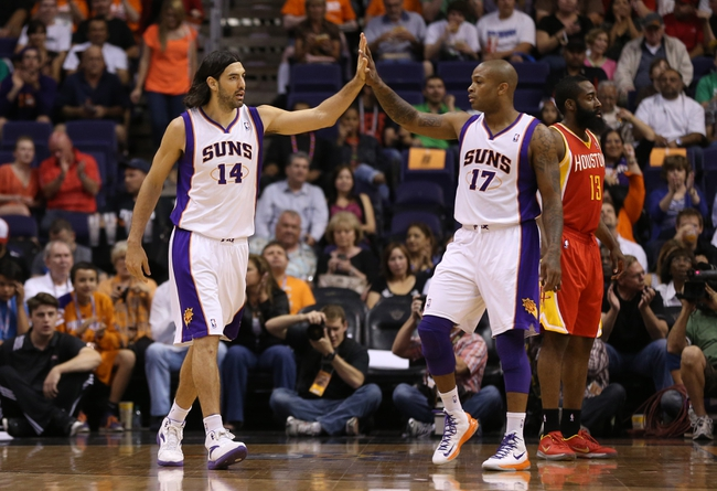 Apr. 15, 2013; Phoenix, AZ, USA: Phoenix Suns forward Luis Scola (14) celebrates with forward P.J. Tucker (17) in the first quarter against the Houston Rockets at the US Airways Center. Mandatory Credit: Mark J. Rebilas-USA TODAY Sports