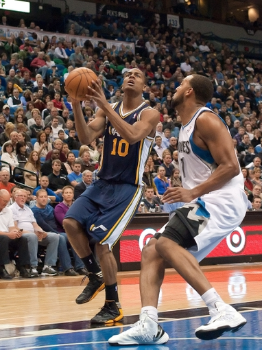 Apr 15, 2013; Minneapolis, MN, USA; Utah Jazz point guard Alec Burks (10) drives to the basket and Minnesota Timberwolves power forward Derrick Williams (7) defends in the fourth quarter at Target Center. The Jazz won 96-80. Mandatory Credit:  Greg Smith-USA TODAY Sports