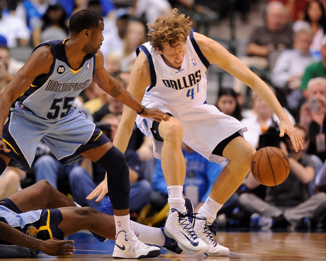 Apr 15, 2013; Dallas, TX, USA; Dallas Mavericks power forward Dirk Nowitzki (41) twists his ankle while being defended by Memphis Grizzlies point guard Keyon Dooling (55) during the second half at the American Airlines Center. The Grizzlies defeated the Mavericks 103-97. Mandatory Credit: Jerome Miron-USA TODAY Sports